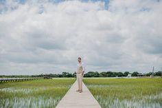 Groom stands on dock in Shem Creek, Creek Club at I'on, Charleston, South Carolina. Kate Timbers Photography. http://katetimbers.com #katetimbersphotography // Charleston Wedding Photography // Posing Inspiration