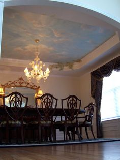 Fragonard inspired clouds. I love a ceiling that looks like the sky.