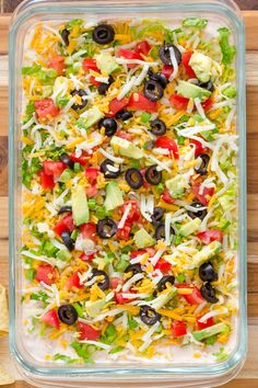 """My Skinny Taco Dip is a lightened up version of the classic 7 Layer Dip and the perfect appetizer for game day parties. Made """"skinny"""" with light cream cheese and fat-free greek yogurt, this Skinny Taco Dip is a fan favorite and will always disappear fast! Dip Recipes, Mexican Food Recipes, Appetizer Recipes, Appetizer Party, Cooking Recipes, Party Dips, Skinny Taco Dip, Layered Taco Dip, Game Day Appetizers"""