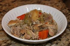 Place the chicken in the slow cooker and sprinkle with sea salt and black pepper. On top of the chicken layer the onions and whole garlic cloves followed by the parsnips, carrots, and celery
