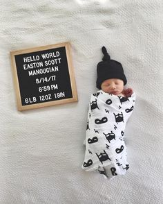 Well your mama made you pretty and your mama made you sweet. Your daddy gave you day dreams and more cushion in your seat. Your mama gave you those windows to your soul, your daddy got more love for you then you could ever know. You remind me of you.    Sweetest words and sweetest photo with our Hero Struck swaddle blanket.