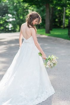 Romantic wedding dress idea - A-line wedding gown with lace edges + strapless neckline {Photo by Laura Kelly Photography}
