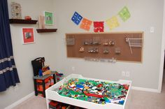 Lego board.  Pegboard with clear acrylic display boxes I bought online.  No, they aren't always all in their place or organized by size and color, but maybe one day.  For now at least there is a place to put them all.  And it's not one big bin that has to be dumped out on the floor to find the piece they are looking for.  Works for us!