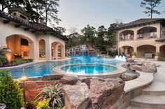 We'd love to spend a weekend at this backyard pool with integrated spa, rock waterfalls, fountain bubblers and beautiful patio | Texas Pools Inc., The Woodlands, TX http://www.poolspaoutdoor.com/photos/award-winning-pools/2014-apsp-award-winning-pools.aspx?edgpid=6045edgmid=16074#!prettyPhoto_M16074/id6045/
