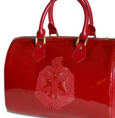 A cute Ruby Red Patent leather hand bag. NOTE: This link will take you to a closed online site.