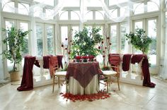 A holiday scene accented with trees and natural light. Romantic red roses fall  around the head table. Birch Hill Events #NY #Wedding #Albany #Light