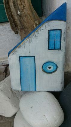 Blue like the Greek sea and evil eye. Pallet wood handmade little home by Anna Vassila