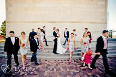 Neat idea. Have the bridal party blurred like time is passing while the couple is standing still,