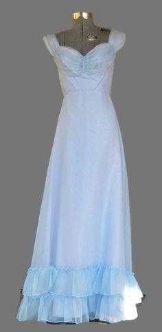 1970s Formal Bridesmaid Lavender Blue dress Size XS Empire Waist Color: Pale Lavender or Ice blue Dead stock, never been worn Lot number 10076 Condition: Very Good* Measurements taken with garment lay