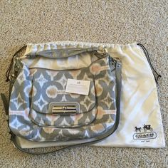 Coach Kristin Hobo Ikat print with a beautiful subtle sparkle in the fabric. Includes detachable cross body strap, care card, and dust bag. Great condition, very small mark on back of bag as shown in picture. Coach Bags Shoulder Bags