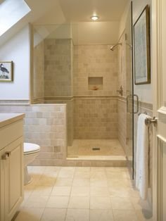 Gorgeous bathroom using Cream 4x4 stone tile throughout. https://www.pebbletileshop.com/products/Cream-4x4-Stone-Mosaic-Tile.html#.VOunEPnF-1U Natural stone in these shades always look so warm!