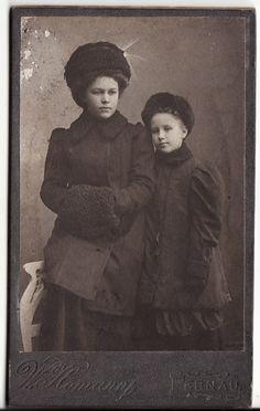 Teenage girls in winter coats, fur hats and muff, 1910