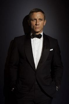 "Quantum of Solace, James Bond Tuxedo -- ""Ford chose to put Bond in a shawl-collared tuxedo, rather than the classic peak lapel style that Bond usually wears (see ""Casino Royale"" and any of the older films). The shawl-collar is a curved, less masculine line, whereas the peak lapel accentuates the masculine, inverted triangle shape that we associate with men."""