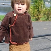It is super warm jacket,made of thick velvet.In brown color,wooden buttons and knitted edges.Can be washed in a washer.Fit nicely for a boy 1.5-2 years of age.