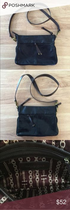 Tignanello brown and black leather shoulder purse Good condition, as seen in pictures! Fast same or next day shipping! Open to offers but I don't negotiate in the comments so please use the offer button Dimensions: left to right- 10.5 inches, top to bottom- 8 inches strap length- 23 inches Tignanello Bags Shoulder Bags
