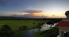 Sunset view from the roof deck of an Inspirato penthouse in Dorado, Puerto Rico.