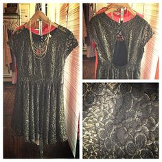 This pyrite colored floral dress ($76) and gold necklace ($55) is perfect for an evening event. Sleek and classy with a little sheen.
