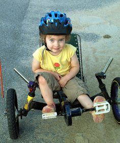 """Child-sized recumbent trike: """"I was keen to get her started on a bicycle, but realized she didn't have [the] coordination to balance and learn to pedal at the same time. I decided to build her a recumbent trike so she would be able to get around without the risk of wiping out..."""" 