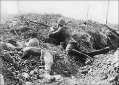 VERDUN 1916-2016: German soldier with French dead during the Battle of Verdun, 1916.