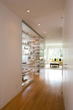 Glass bookshelves at San Francisco home by Envelope Architecture+Design