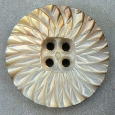 (::)  Carved iridescent vintage white/smokey pearl shell button.