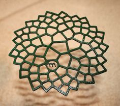 Above is a laser cut leather coaster from Pete Blacker.