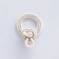 A Coil hung from a hook or stake can be unfurled quickly so it is a good solution for frequently-used rope.  #yearofknots #knotaday #windychienmacrame #macrame #knot #rope #modernmacrame #dsshapes #craftsposure #dswhite #fiberart #coil by windychien