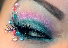 Jewels enhance pretty pink and blue eye shadow.