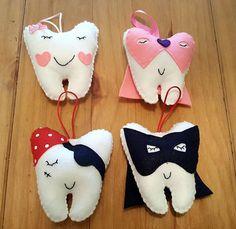 Tooth fairy pocket pillows. Felt tooth pillow