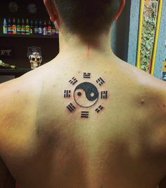 Yin Yang tattoo with the I-Ching symbols. There are a lot of types of Yin Yang tattoo and this is one part where it combines with another element which is the I-Ching.