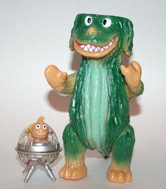 Zollmen Green Popy Dog, awesome sofubi! http://www.viciousfun.com/kaiju/zollmen.html