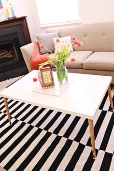 Add simple legs to an Ikea table top for a midcentury-style coffee table, if you prefer to skip the cushioned ottoman.
