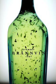"Akvavit Brannvin Svenskt - Brännvin (literally ""burn-wine"") is liquor distilled from fermented grain or potatoes. Akvavit is Brannvin seasoned with herbs. Scottish Fashion, Danish Food, Wine And Spirits, Whisky, Rum, Sweden, Liquor, Life Is Good, Beverages"