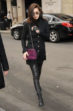 Pin for Later: 32 Pics That Prove Bella Hadid Is Style Queen of the Streets  Pulling a Karl Lagerfeld with one fingerless leather glove, all-black separates, and a standout plum Chanel bag.