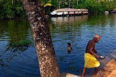 https://flic.kr/p/xvragd | Bath. Kumarakom, India | Men bathing in the peaceful backwaters, by a traditional houseboat near Kottayam in Kerala, South India.
