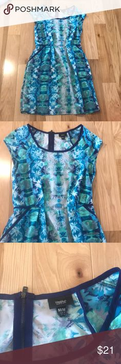 Mossimo spring dress Blue, green and white 100% polyester dress with a watercolor tie dye-ish abstract floral pattern. The silky dress is very comfortable with a stretchy elastic waist band along the back half of the dress. It has pockets with dark blue accent piping and a zipper closure in back. Worn once, excellent used condition. Mossimo Supply Co. Dresses