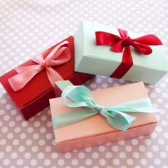contrasting colors of boxes and bows