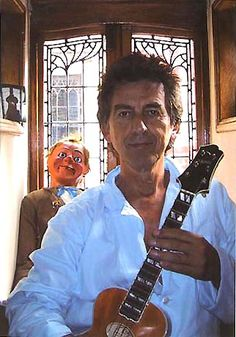 George Harrison early 90's with his ukulele.