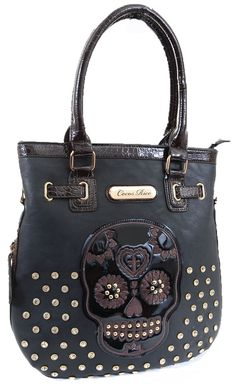Be happy carrying this day of the dead purse. You can take just about anything with you when you don this Trendy Sugar Skull Embroidered Faux Leather Purse. This fashion handbag features faux vegan fr