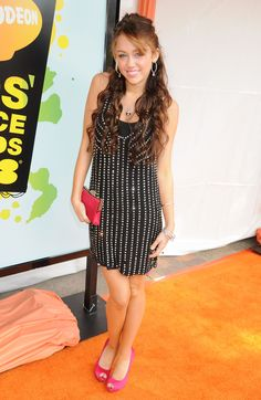 Miley Cyrus (KCAs 2008)  in high school i found this dress online and stalked it everyday when the price went down, never went down enough though.