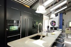 Cool, contemporary kitchen design in black and silver. From 1 of 28 projects by Renovation Design Group. #interiors #interiordesign