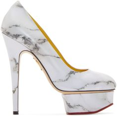 Leather platform pumps featuring marble print throughout in tones of grey. Almond toe. Island platform trimmed in red leather at base. Raised gold-tone logo at sole. Tonal stitching. Approx. 5.5