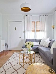 Moroccan rug, brass / glass coffee table and grey couch = styling perfection