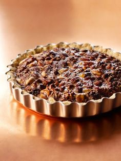 Pecan-Plus Pie, from chef Nigella Lawson. Made with a mix of nuts, best eaten warm with a scoop of vanilla ice cream. Winter Cakes, Nigella Lawson, Cheesecakes, Pecan Nuts, Maple Pecan, Nut Recipes, Salted Chocolate, Sweet Pie, Mixed Nuts