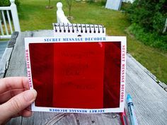 Secret Agent Kit: Message Decoder « Stitch-Craft - Write a message in light blue pen, then scribble over it w/red pen; when you hold red film over the paper, the message is revealed!