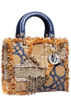 Patchwork look on the classic Lady Dior handbag.  Bold.  Would look fabulous with every pair of jeans you own.