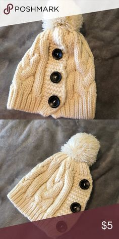 Ladies Cream Winter Hat Super cute,  cream colored, medium sized ladies winter hat with Pom Pom and decorative buttons. Will add in as a free gift with purchase of any other winter jackets in my closet. Otherwise will sell separately. Worn twice in perfect condition. Accessories Hats