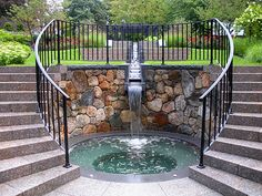 The cascading water into the hidden spa appears to flow from the long descending stone runnel, but is actually coming from a separate system.