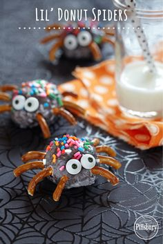 Kids will love these spooky snacks for Halloween. Stick pretzel pieces and candy eyes on Pillsbury® Funfetti® Glazed Chocolate Lil' Donuts. #lildonutspromo