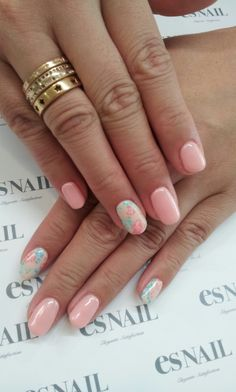 Pastel pink nails with pastel floral accent nails.